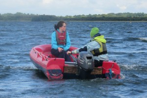 Fodhla Summer Camp Lough Lene Aoife with Anna in Loch Rinn rescue boat July 2015